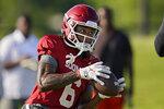Oklahoma wide receiver Cody Jackson catches a pass during an NCAA college football practice, Tuesday, Aug. 10, 2021, in Norman, Okla. (AP Photo/Sue Ogrocki)