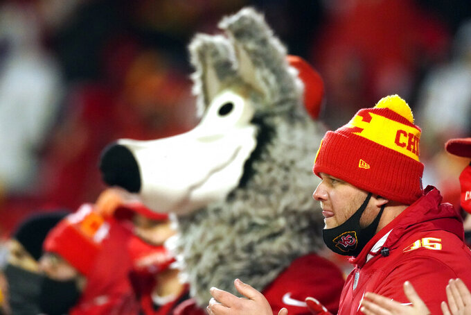 Fans watch from the stands during the second half of the AFC championship NFL football game between the Kansas City Chiefs and the Buffalo Bills, Sunday, Jan. 24, 2021, in Kansas City, Mo. (AP Photo/Charlie Riedel)