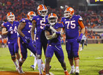 Clemson's Travis Etienne, front, celebrates his touchdown with teammates during the second half of an NCAA college football game against Duke on Saturday, Nov. 17, 2018, in Clemson, S.C. (AP Photo/Richard Shiro)