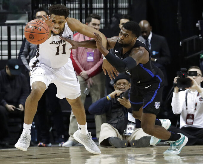 St. Bonaventure forward Courtney Stockard (11) and Saint Louis guard Tramaine Isabell Jr. (2) compete for the ball during the second half of an NCAA college basketball game in the Atlantic 10 men's tournament final Sunday, March 17, 2019, in New York. Saint Louis won 55-53. (AP Photo/Julio Cortez)