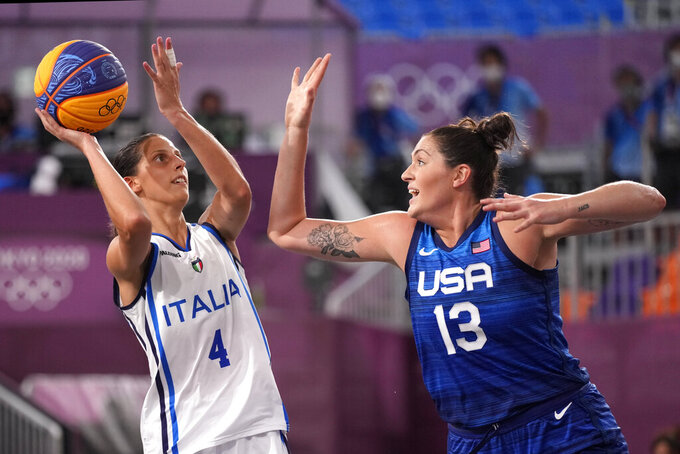 Chiara Consolini (4), of Italy, shoots under pressure from Stefanie Dolson (13), of the United States during a women's 3-on-3 basketball game at the 2020 Summer Olympics, Monday, July 26, 2021, in Tokyo, Japan. (AP Photo/Charlie Riedel)