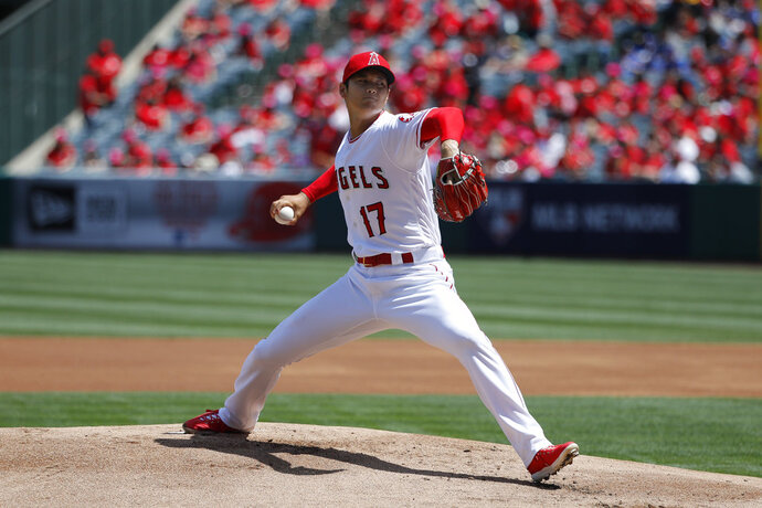 FILE - In this Sunday, April 8, 2018, file photo, Los Angeles Angels starting pitcher Shohei Ohtani, of Japan, throws against the Oakland Athletics during the first inning of a baseball game,  in Anaheim, Calif. Ohtani makes his third Major League Baseball start when the Los Angeles Angels host David Price and the Boston Red Sox in a marquee matchup between the top two teams in the majors, beginning Tuesday, April 17, 2018. (AP Photo/Jae C. Hong, File)