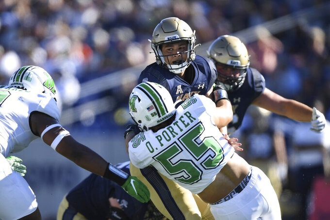 Navy quarterback Tai Lavatai (1) is sacked by Marshall defensive lineman Owen Porter (55) during the first half of an NCAA college football game, Saturday, Sept. 4, 2021, in Annapolis, Md. (AP Photo/Terrance Williams)