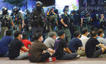 Police detain protesters against the new security law during a march marking the anniversary of the Hong Kong handover from Britain to China, Wednesday, July. 1, 2020, in Hong Kong. Hong Kong marked the 23rd anniversary of its handover to China in 1997 just one day after China enacted a national security law that cracks down on protests in the territory. (AP Photo/Vincent Yu)