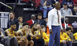 Wyoming coach Allen Edwards and his bench watch during the final moments of the second half of an NCAA college basketball game against New Mexico in the Mountain West Conference men's tournament Wednesday, March 13, 2019, in Las Vegas. (AP Photo/Isaac Brekken)
