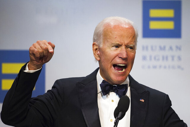 "FILE--In this Sept. 15, 2018, file photo, former Vice President Joe Biden addresses the Human Rights Campaign National Dinner in Washington, D.C. On May 6, 2012, Vice President Joe Biden declared on ""Meet the Press"" that he supported the legalization of same-sex marriage – getting out ahead of his boss, Barack Obama, on one of the most volatile political issues of the day. The largest national LGBTQ-rights organization, the Human Rights Campaign, will be formally endorsing Biden for president on Wednesday, the eighth anniversary of that event. (AP Photo/Cliff Owen, file)"