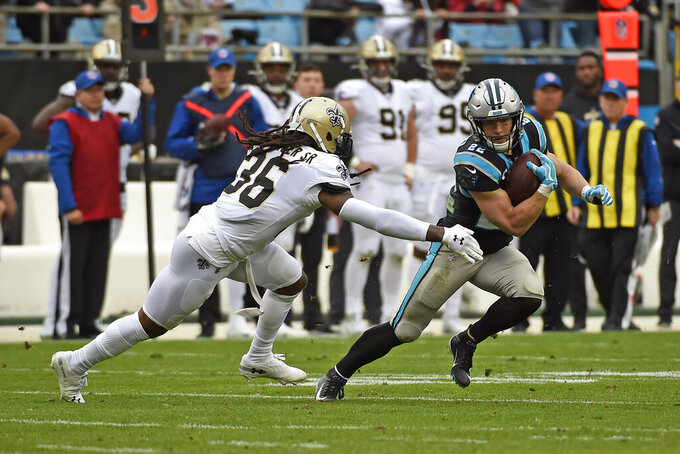 Carolina Panthers running back Christian McCaffrey (22) runs against New Orleans Saints free safety D.J. Swearinger (36) during the first half of an NFL football game in Charlotte, N.C., Sunday, Dec. 29, 2019. (AP Photo/Mike McCarn)