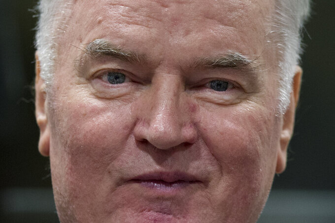 FILE - In this Wednesday, Nov. 22, 2017 file photo, Bosnian Serb military chief Ratko Mladic enters the Yugoslav War Crimes Tribunal in The Hague, Netherlands, to hear the verdict in his genocide trial. Former Bosnian Serb military chief Gen. Ratko Mladic said Friday, July 24, 2020 that his health is bad and getting worse, as his lawyers sought another delay in a United Nations hearing in his appeal against convictions for genocide, war crimes and crimes against humanity. (AP Photo/Peter Dejong, Pool, File)