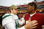New York Jets quarterback Sam Darnold (14) speaks with Washington Redskins quarterback Dwayne Haskins (7) after an NFL football game, Sunday, Nov. 17, 2019, in Landover, Md. New York Jets won 34-17. (AP Photo/Alex Brandon)