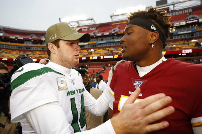 New York Jets quarterback Sam Darnold (14) speaks with Washington Redskins quarterback Dwayne Haskins (7) after an NFL football game, Sunday, Nov. 17, 2019, in Landover, Md. New York Jets won 34-17. (AP Photo/Alex Brandon)
