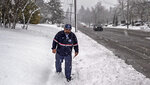 Postal carrier Tom Arndt delivers letters to homes along South 19th Street in Tacoma, Wash., Monday, Feb. 11, 2019.   (Peter Haley/The News Tribune via AP)