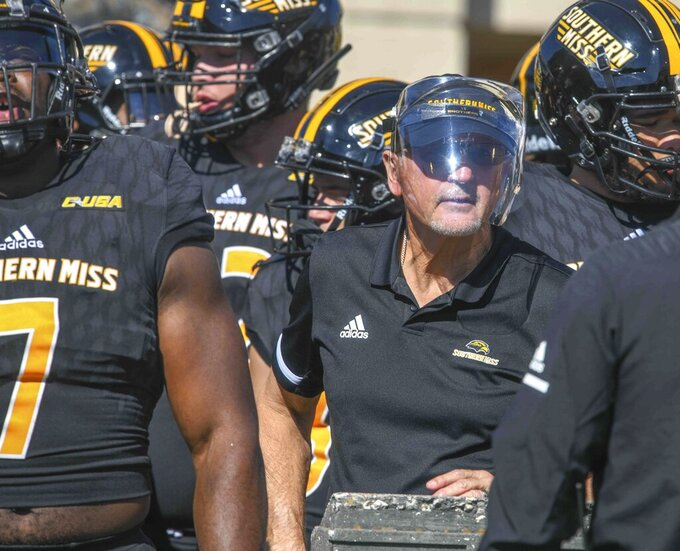 Southern Miss Interim Head Coach Tim Billings prepares to enter the field for an NCAA college football game against Rice in Hattiesburg, Miss., Saturday, Oct. 31, 2020. (Cam Bonelli/Hattiesburg American via AP)