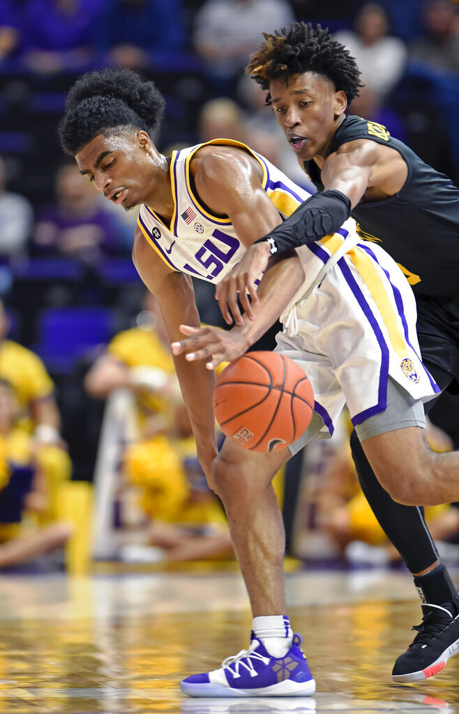 Maryland-Baltimore COunty guard Keondre Kennedy, right, reaches over LSU guard James Bishop to knock the ball away, but fouls in the process during the second half of an NCAA college basketball game Tuesday, Nov. 19, 2019, in Baton Rouge, La. LSU won 77-50. (AP Photo/Bill Feig)