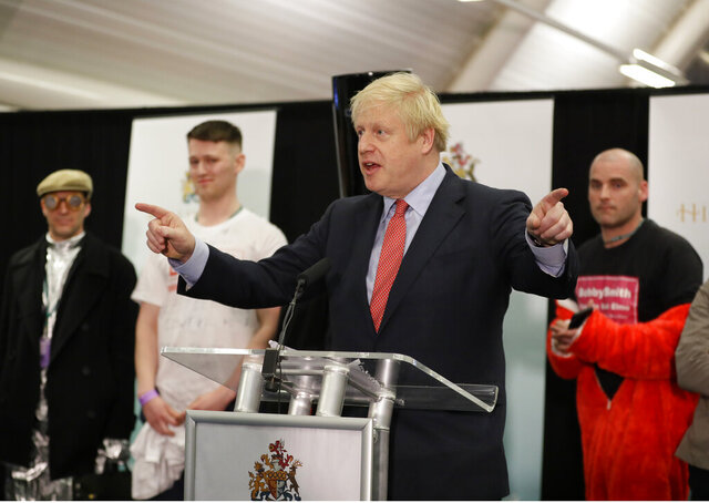 Britain's Prime Minister and Conservative Party leader Boris Johnson gestures as he speaks after the Uxbridge and South Ruislip constituency count declaration at Brunel University in Uxbridge, London, Friday, Dec. 13, 2019. (AP Photo/Kirsty Wigglesworth)