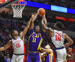 LSU forward Kavell Bigby-Williams (11) goes up for a rebound against Mississippi guard Luis Rodriguez (15) and forward Bruce Stevens (12) during the first half of an NCAA college basketball game in Oxford, Miss., Tuesday, Jan. 15, 2019. Rodriguez was called for a foul on the play. (AP Photo/Thomas Graning)