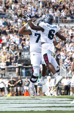Central Florida wide receiver Marlon Williams (6) celebrates his touchdown with offensive lineman Samuel Jackson (73) during the first half of an NCAA college football game against Houston in Orlando, Fla., Saturday, Nov. 2, 2019. (Photo/Willie J. Allen Jr.)