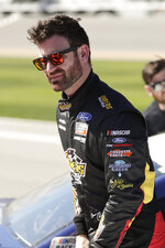 Corey LaJoie walks along pit road after his run at NASCAR auto race qualifying at Daytona International Speedway, Sunday, Feb. 9, 2020, in Daytona Beach, Fla. (AP Photo/John Raoux)
