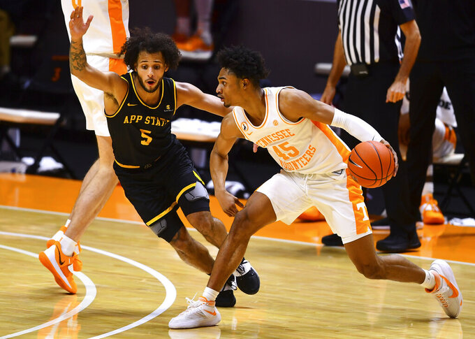 Tennessee forward Corey Walker Jr. (15) moves past Appalachian State guard Michael Almonacy (5) during an NCAA college basketball game in Knoxville, Tenn., on Tuesday, Dec. 15, 2020.  (Brianna Paciorka/Knoxville News Sentinel via AP)