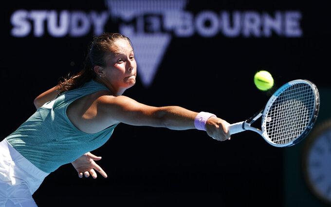 Russia's Daria Kasatkina makes a backhand return to Aryna Sabalenka of Belarus during their second round match at the Australian Open tennis championship in Melbourne, Australia, Wednesday, Feb. 10, 2021.(AP Photo/Rick Rycroft)