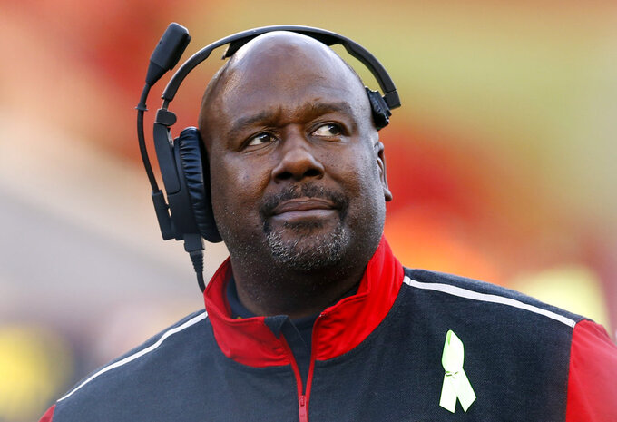 FILE - In this Nov. 21, 2015, file photo, then-Maryland interim head coach Mike Locksley watches from the sideline during an NCAA college football game against Indiana, in College Park, Md. New Alabama offensive coordinator Mike Locksley will make $1.2 million annually and defensive coordinator Tosh Lupoi is set to earn $1.1 million. Trustees approved deals for 10 Crimson Tide assistants Monday, May 7, 2018 with only offensive line coach Brent Key remaining in the same job. Both coordinators have three-year deals. (AP Photo/Patrick Semansky, File)