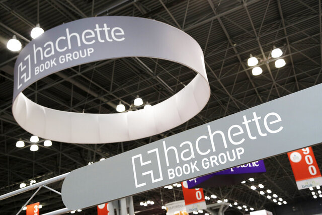 FILE - This May 28, 2015 file photo shows signs for Hachette Book Group displayed at BookExpo America in New York. Publishing's annual national convention, BookExpo, has been postponed until July. Organizers cited concerns about the coronavirus in rescheduling the gathering, originally scheduled to take place in late May at the Jacob Javits Convention Center in Manhattan. (AP Photo/Mark Lennihan, File)