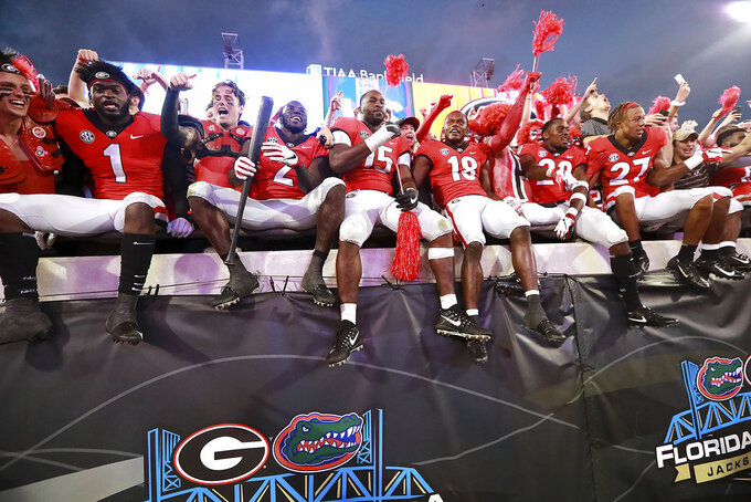 Georgia players celebrate a 36-17 victory over Florida after an NCAA college football game, Saturday, Oct 27, 2018, in Jacksonville, Fla. (Curtis Compton/Atlanta Journal-Constitution via AP)
