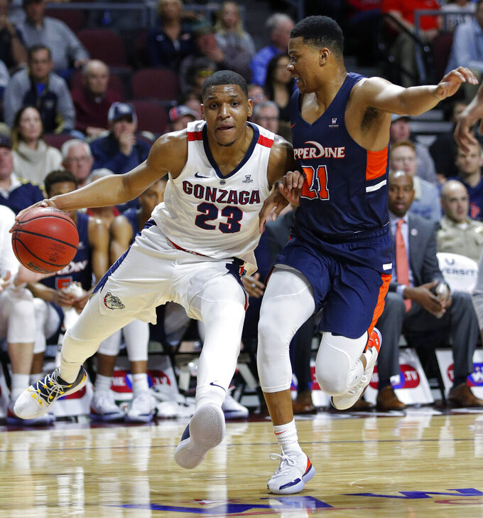 Gonzaga's Zach Norvell Jr., left, drives around Pepperdine's Eric Cooper Jr. during the first half of an NCAA semifinal college basketball game at the West Coast Conference tournament, Monday, March 11, 2019, in Las Vegas. (AP Photo/John Locher)