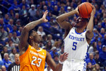 Kentucky's Immanuel Quickley (5) shoots while defended by Tennessee's Jordan Bowden (23) during the first half of an NCAA college basketball game, Tuesday, March 3, 2020, in Lexington, Ky. (AP Photo/James Crisp)