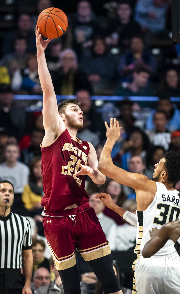 Boston College forward Nik Popovic (21) shoots over Wake Forest center Olivier Sarr (30)  during an NCAA college basketball game, Saturday, Jan. 26, 2019, in Winston-Salem, N.C. (Andrew Dye/The Winston-Salem Journal via AP)
