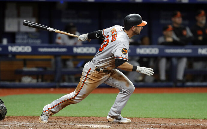 Baltimore Orioles' Joey Rickard watches his RBI double off Tampa Bay Rays relief pitcher Diego Castillo during the 11th inning of a baseball game Thursday, April 18, 2019, in St. Petersburg, Fla. Chris Davis scored. (AP Photo/Chris O'Meara)