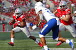 Ohio State running back TreVeyon Henderson, left, cuts upfield against Tulsa defensive back LJ Wallace during the first half of an NCAA college football game Saturday, Sept. 18, 2021, in Columbus, Ohio. (AP Photo/Jay LaPrete)