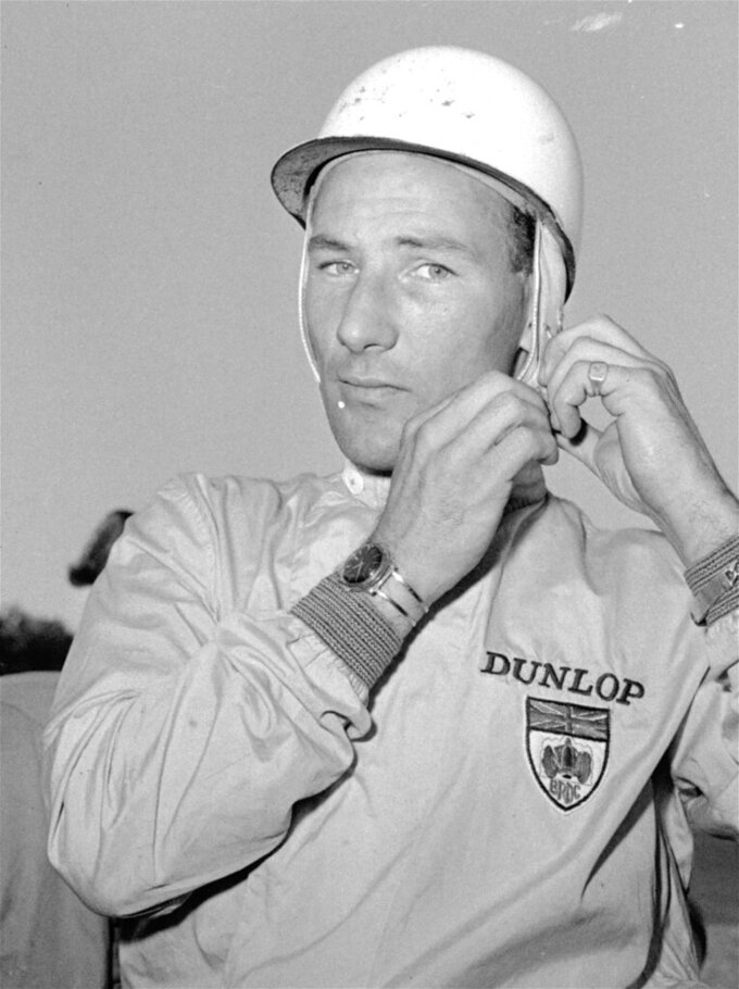FILE - In this Black and White file photo dated October 7, 1961, legendary British driver Stirling Moss at the U.S. Grand Prix at Watkins Glen, New York. Stirling Moss has died at the age of 90, according to an announcement Sunday April 12, 2020, from his family. (AP Photo/stf FILE)