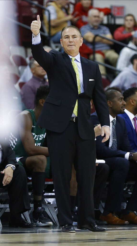 Stetson head coach Donnie Jones signals to his team during the first half of an NCAA college basketball game against Ohio  State, Monday, Nov. 18, 2019, in Columbus, Ohio. (AP Photo/Jay LaPrete)