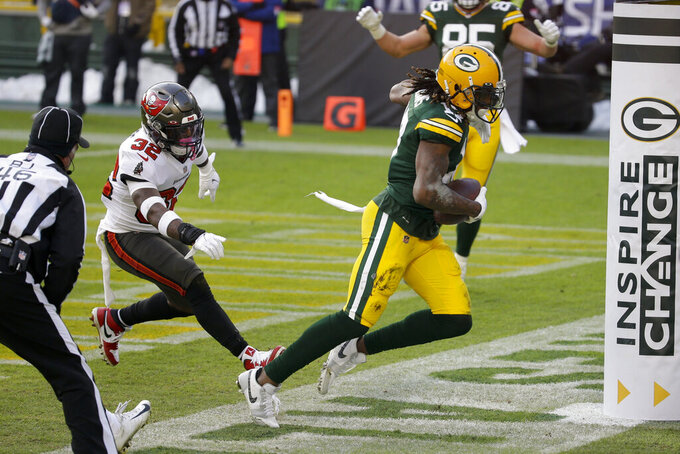 Green Bay Packers' Davante Adams (17) catches a pass out of bounds in the end zone against the Tampa Bay Buccaneers during the first half of the NFC championship NFL football game in Green Bay, Wis., Sunday, Jan. 24, 2021. (AP Photo/Mike Roemer)