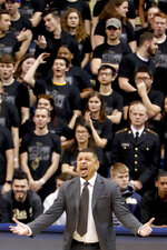 Pittsburgh head coach Jeff Capel, bottom yells at an official as the student section stands behind him during the first half of an NCAA college basketball game against North Carolina State, Saturday, Feb. 9, 2019, in Pittsburgh. North Carolina State won 79-76.(AP Photo/Keith Srakocic)