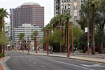 A typically busy downtown Phoenix Wednesday, April 1, 2020 is mostly idle during the first full day of Arizona Gov. Doug Ducey's stay-at-home order to slow the spread of the new coronavirus. Gov. Ducey is urging Arizonans to be understanding and reasonable as people and businesses face April 1 due dates for bills such as mortgages, rent, utilities and internet service since the COVID-19 coronavirus outbreak has slowed the economy. The new coronavirus causes mild or moderate symptoms for most people, but for some, especially older adults and people with existing health problems, it can cause more severe illness or death. (AP Photo/Matt York)