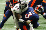 Atlanta Falcons linebacker Foye Oluokun (54) sacks Denver Broncos quarterback Drew Lock (3) during the first half of an NFL football game, Sunday, Nov. 8, 2020, in Atlanta. (AP Photo/Brynn Anderson)
