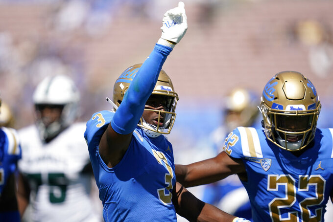 UCLA defensive back Cameron Johnson (3) celebrates after a stop during the second half of an NCAA college football game against Hawaii Saturday, Aug. 28, 2021, in Pasadena, Calif. (AP Photo/Ashley Landis)