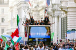 Italy's players celebrate in Rome, Monday, July 12, 2021, their victory of the Euro 2020 soccer championships in a final played at Wembley stadium in London on Sunday. Italy beat England 3-2 in a penalty shootout after a 1-1 draw. (Mauro Scrobogna/LaPresse via AP)