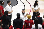 Louisville head coach Jeff Walz talks to his team during a timeout in the first half of an NCAA college basketball game against DePaul, Friday, Dec. 4, 2020, in Uncasville, Conn. (AP Photo/Jessica Hill)