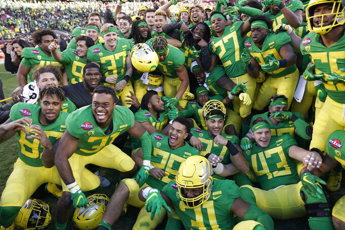Oregon players celebrate after a win over Michigan State during the Redbox Bowl NCAA college football game Monday, Dec. 31, 2018, in Santa Clara, Calif. (AP Photo/Tony Avelar)