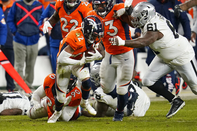 Denver Broncos cornerback Parnell Motley (42) recovers a fumble against Las Vegas Raiders center Rodney Hudson (61) during the second half of an NFL football game, Sunday, Jan. 3, 2021, in Denver. (AP Photo/David Zalubowski)