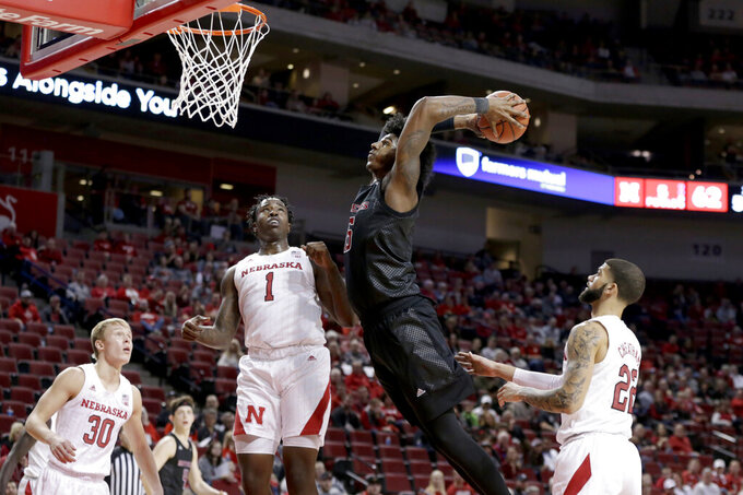 Nebraska's Charlie Easley (30), Kevin Cross (1) and Haanif Cheatham (22) watch as Rutgers' Myles Johnson (15)] goes up for a dunk during the second half of an NCAA college basketball game in Lincoln, Neb., Friday, Jan. 3, 2020. Rutgers won 79-62. (AP Photo/Nati Harnik)