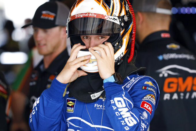 John Hunter Nemechek puts on his helmet during practice for a NASCAR Xfinity Series auto race, Saturday, June 15, 2019, at Iowa Speedway in Newton, Iowa. (AP Photo/Charlie Neibergall)