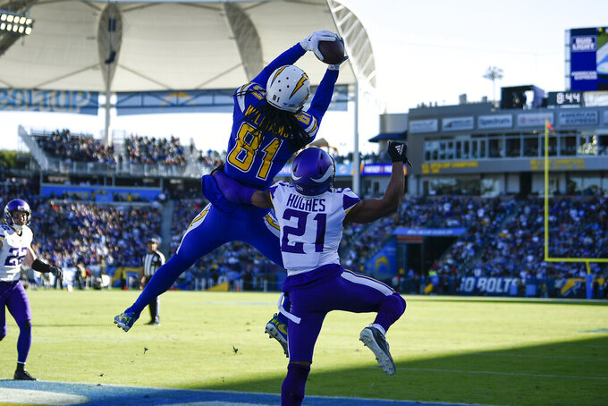 Los Angeles Chargers wide receiver Mike Williams (81) grabs a touchdown catch in the end zone as Minnesota Vikings cornerback Mike Hughes (21) defends during the first half of an NFL football game Sunday, Dec. 15, 2019, in Carson, Calif. (AP Photo/Kelvin Kuo)