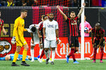 Atlanta United defender Leandro Gonzalez, second from right, celebrates next to New England Revolution defender Andrew Farrell (2) as time runs out in round one of an MLS Cup playoff soccer game Saturday, Oct. 19, 2019, in Atlanta. Atlanta won 1-0. (AP Photo/John Amis)