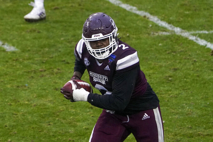 Mississippi State linebacker Tyrus Wheat (2) runs after an interception against Tulsa during the second half of the Armed Forces Bowl NCAA college football game Thursday, Dec. 31, 2020, in Fort Worth, Texas. (AP Photo/Jim Cowsert)