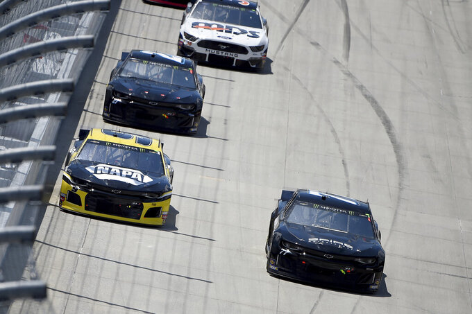 Chase Elliott (9) and Quin Houff (77) race in front of Reed Sorenson (27) during the NASCAR Cup Series auto race, Monday, May 6, 2019, at Dover International Speedway in Dover, Del. (AP Photo/Will Newton)