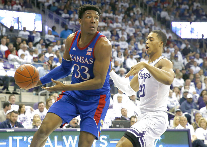 Kansas forward David McCormack (33) looks to pass as TCU forward Jaedon LeDee (23) defends during the first half of an NCAA college basketball game, Saturday, Feb. 8, 2020, in Fort Worth, Texas. (AP Photo/Ron Jenkins)
