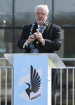 In this March 18, 2019, photo, Minnesota United FC Loons managing partner, Bill McGuire, addresses soccer supporters at a scarf raising ceremony in advance of the MSL soccer team's home opener April 13 against New York City FC in the new privately -funded Allianz Field stadium in St. Paul, Minn. (AP Photo/Jim Mone)
